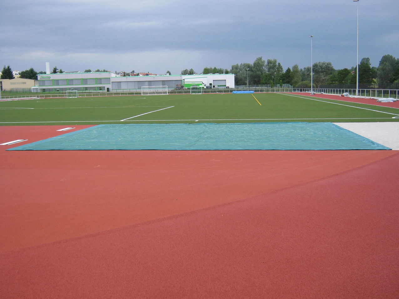 Sandpit cover for long jump facilities