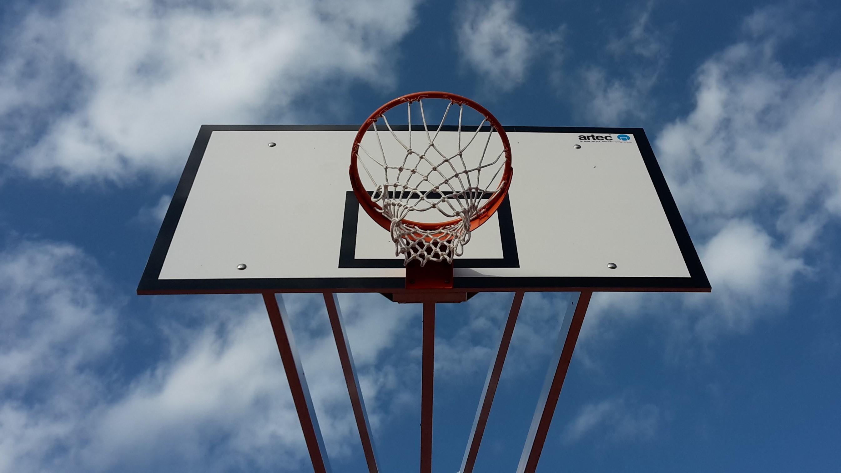 Basketball post with backboard and hoop