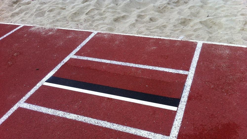 take-off board in front of sandpit